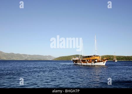 A sailboat sails through the Adriatic Sea, nearby Korčula Island (Croatia) - Stock Photo