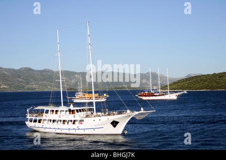 Sailing boats sailing through the Adriatic Sea, nearby Korčula Island (Croatia) - Stock Photo