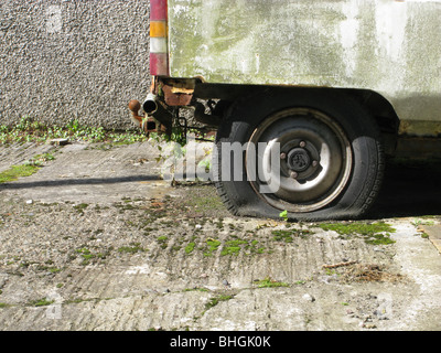 old van with flat tyre wheel - Stock Photo
