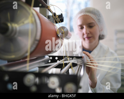 Technician Weaving Medical Product - Stock Photo