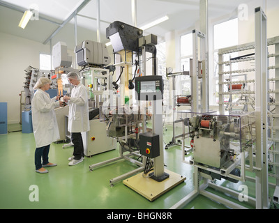 Technicians Weaving Medical Product - Stock Photo