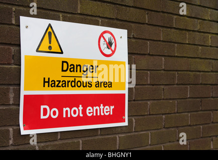 A danger warning sign on a building in the U.K. - Stock Photo