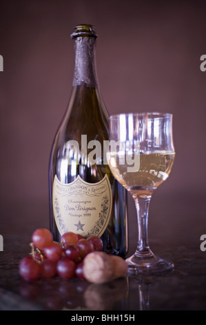 A very expensive bottle of French champagne, Dom Perignon Moet et Chandon a Epernay, has been opened and is ready - Stock Photo