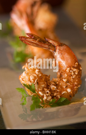 Popcorn Shrimp jumbo Mexican prawns with sea salt scented drawn butter at restaurant in Southern California - Stock Photo