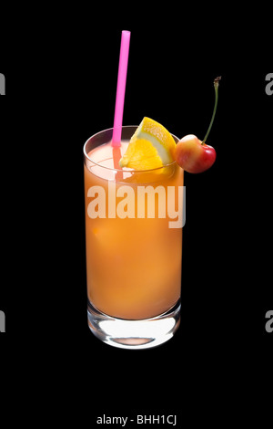 Seabreeze mixed drink with lime and cherry garnish on black background - Stock Photo