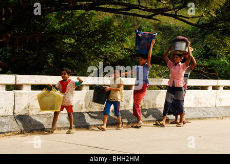 karen refugee's going to stream to wash clothes, mae la refugee camp , near mae sot , north thailand - Stock Photo