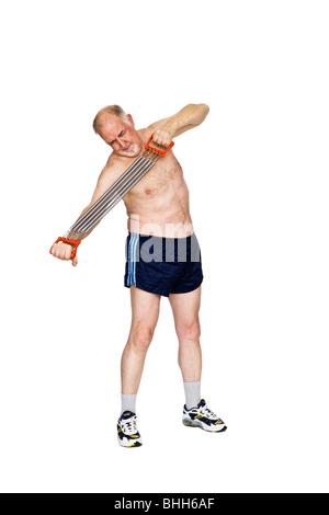 Senior man with a training apparatus. - Stock Photo