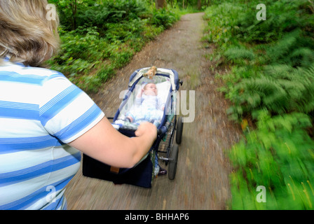 A baby in a perambulator, Sweden. - Stock Photo