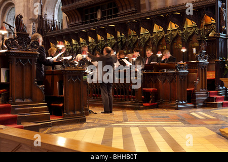 Beautiful vocals and harmony at choir practice inside the capacious Hereford Cathedral, Herefordshire, England. - Stock Photo