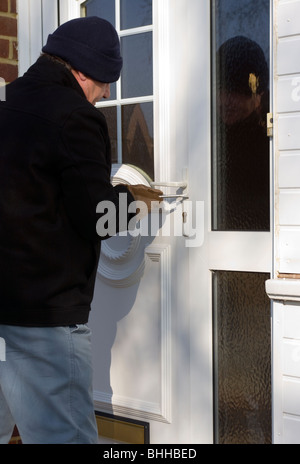 Burglar Forcing A Front Door With A Screwdriver (posed by model) - Stock Photo
