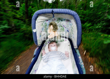 An infant in a perambulator, Sweden. - Stock Photo