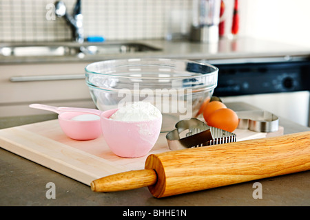 Cookie baking utensils and ingredients in kitchen at home - Stock Photo