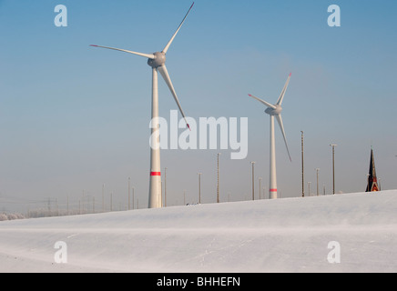 GERMANY Hamburg, Enercon windmill E-126 in Altenwerder during winter - Stock Photo