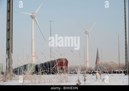 GERMANY Hamburg, Enercon windmill E-126 with 6 MW in Altenwerder during winter, railway transport - Stock Photo