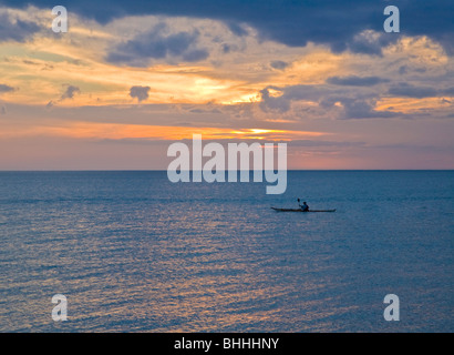 Lone kayaker in the Gulf of Mexico off Venice Beach in Venice Florida at sunset - Stock Photo