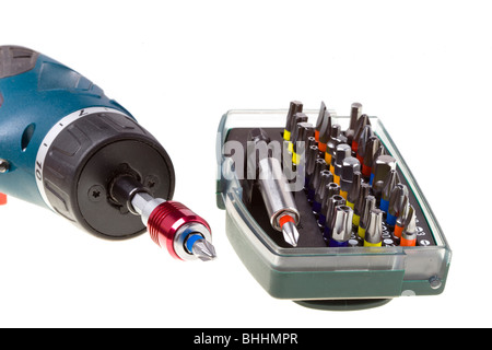 Drill-screwdriver electric storage and set of nozzles on white background - Stock Photo