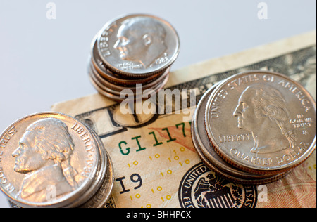 US coins and ten dollar bill on white background - Stock Photo