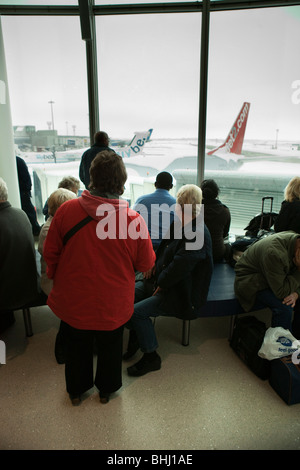 UK, England, Manchester Airport, delayed passengers snowed in after heavy snowfall - Stock Photo