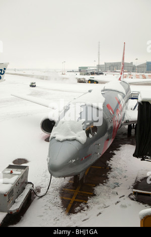 UK, England, Manchester Airport, snowed in jet 2 aircraft after heavy snowfall - Stock Photo