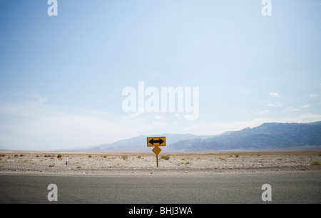 Left or right turn sign at end of road - Stock Photo