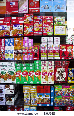 Shop window display of snack foods in Chinatown, London, England - Stock Photo