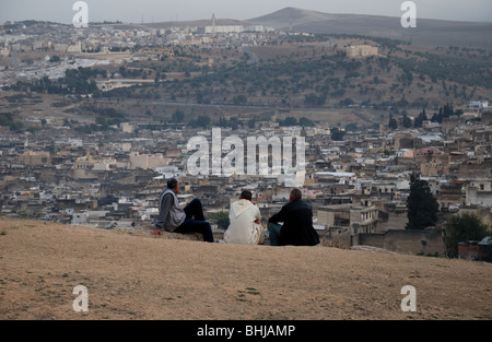 Men watching the view over the Medina in Fes, Morocco. - Stock Photo
