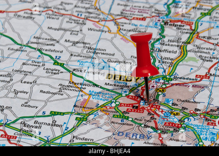 red map pin in road map pointing to city of StokeonTrent Stock
