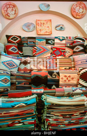 Weaving, pottery, blankets, handicrafts and colorful Indian artwork from the Southwest USA in souvenir shop in Arizona - Stock Photo