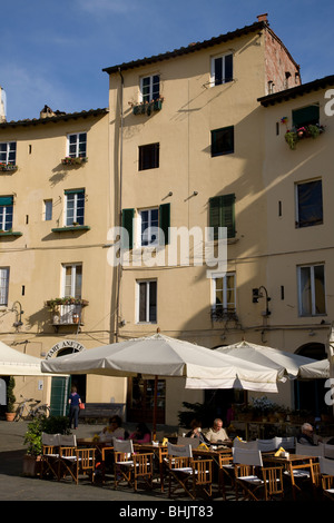 Houses and cafe on Piazza Anfiteatro, Lucca, Tuscany, Italy - Stock Photo