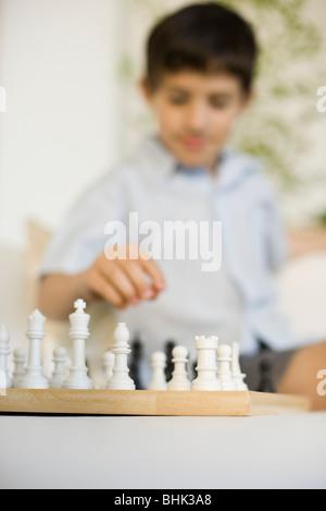 Boy playing chess - Stock Photo