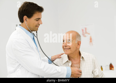 Doctor conducting medical exam - Stock Photo