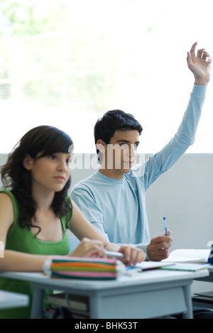 High school students in class, teen boy raising hand - Stock Photo