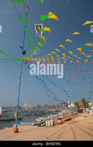India, Kerala, Kovalam, Vizhinjam village seafront, colourful bunting flags outside St Mary's old fisherman's church - Stock Photo