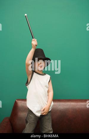 Boy pretending to be magician - Stock Photo