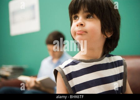 Little boy looking away in thought - Stock Photo