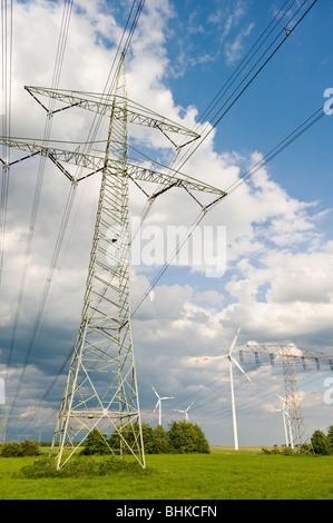 Electricity pylons and windmills near Bernau, Brandenburg, Germany, Europe - Stock Photo