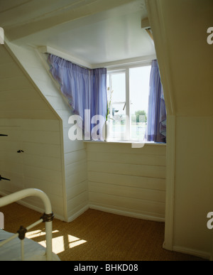 Blue Curtains On Portiere Rods On Awkwardly Shaped Dormer Window In Stock Photo Royalty Free