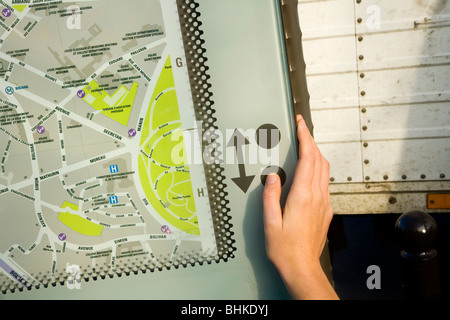 Person looking at an interactive tourist moving information street map of Paris. France. - Stock Photo