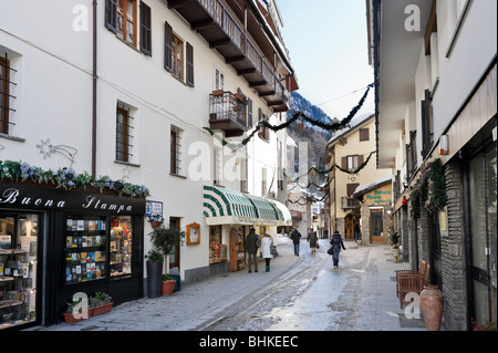 Shops on the Via Roma in the centre of the resort, Courmayeur, Aosta Valley,Italy - Stock Photo