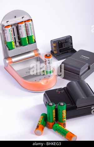 NiMH and Li-ion rechargeable batteries with chargers. Isolated. - Stock Photo
