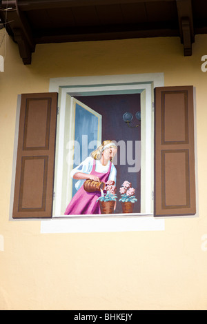 Window painted on the side of a house in Oberammergau, Bavaria, Germany, Europe - Stock Photo