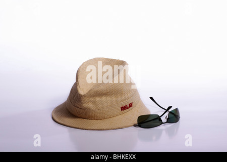 Modern woven straw short-brimmed hat and sunglasses. Isolated. - Stock Photo