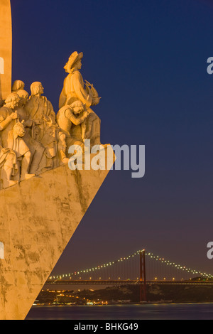 Portugal Lisbon Monument to the discoveries and suspension bridge at twilight - Stock Photo