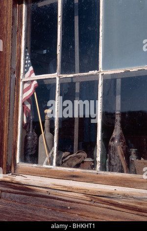 Old Articles in a Window, Bodie State Historic Park, California - Stock Photo