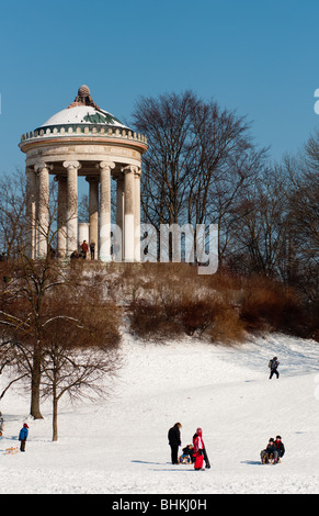 Sledging in English garden, Munich, Germany. - Stock Photo