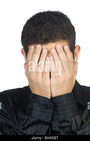 young man head in hands hiding his face - Stock Photo