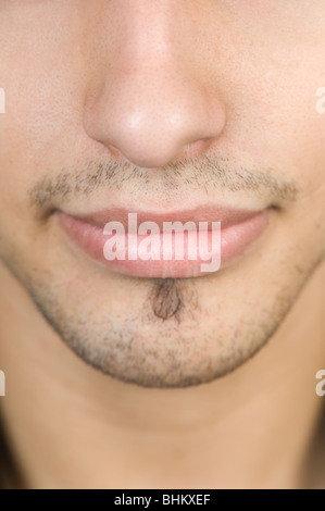 Close up of a young man's mouth and nose - Stock Photo