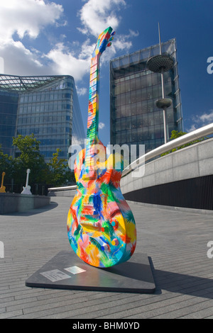 London, Greater London, England. Colourful replica guitar on display on the South Bank near Tower Bridge. - Stock Photo