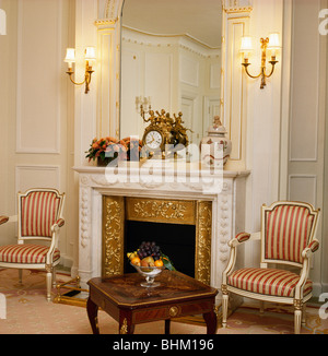 ... Striped Upholstered 17 Century Style Chairs On Either Side Of Fireplace  In Townhouse Living
