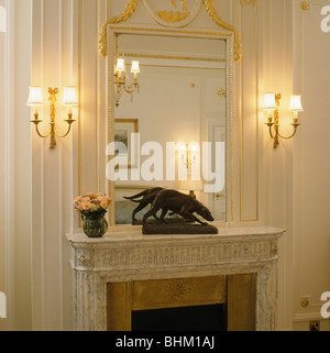 Marble Bedroom Set >> Lighted wall lights on either side of doorway of living room in Stock Photo, Royalty Free Image ...